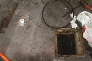 Basement Floor Drain Backs up When Toilet is Flushed